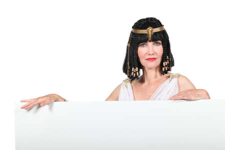 imperious: Woman in Cleopatra costume with blank board ready for text