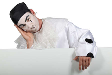 woe: Man in Pierrot costume with a board ready for your text