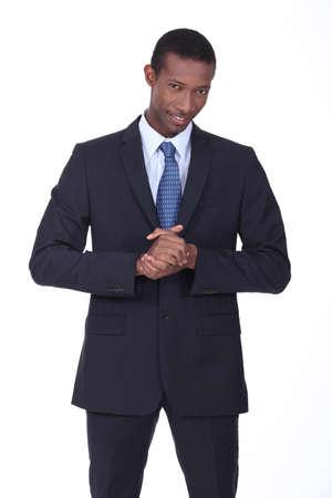 mannequin africain: L'homme se frottant les mains