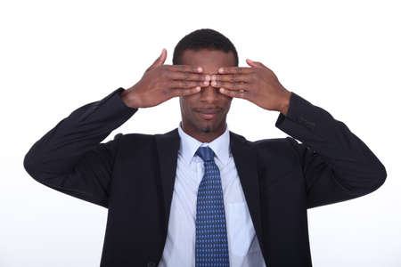 Black man covering his eyes photo