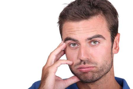 annoyance: Portrait of upset man