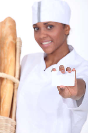 Female bakery worker with business card Stock Photo - 15807695