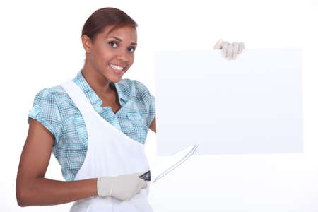 pointed arm: Cook pointing poster with knife Stock Photo