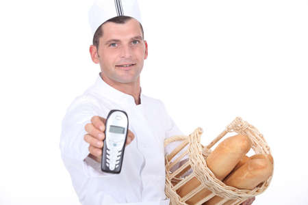 Baker with basket and phone Stock Photo - 15807652