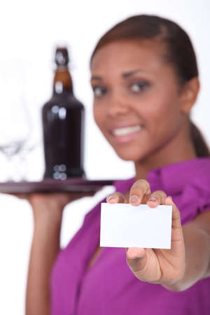 Bar owner showing business card photo