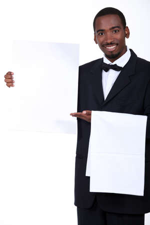 Waiter with a board left blank for your message photo
