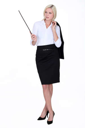 to tight: Blond woman with stick Stock Photo
