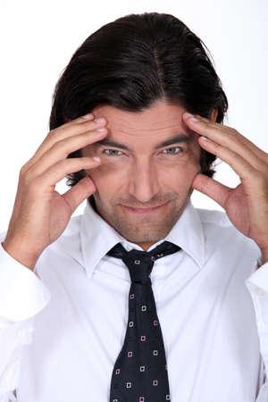 splitting headache: A stressed-out businessman