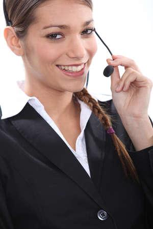 teleoperator: Smiling female telemarketer Stock Photo