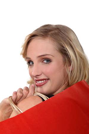 ravishing: close-up portrait of ravishing blonde holding shopping bags Stock Photo