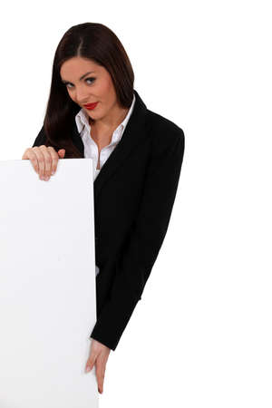 publicist: Businesswoman with a board left blank for your message