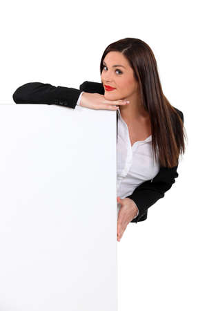 Brunette woman behind white panel Stock Photo - 15807722