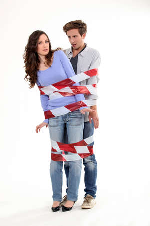 Couple stuck together by tape