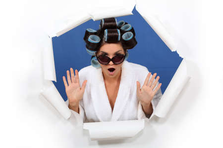 curlers: woman wearing sunglasses with hair curlers Stock Photo