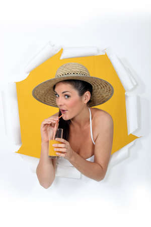 buffoon: a woman drinking orange juice Stock Photo