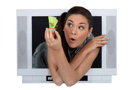 commercial activity: a woman showing a shuttlecock through a screen