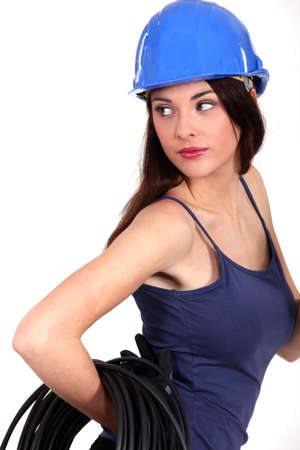 Female electrician posing  photo