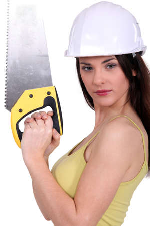 Woman holding up a crosscut saw photo
