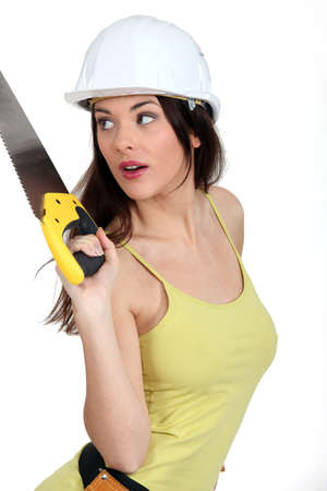 gimmick: Woman with handsaw Stock Photo