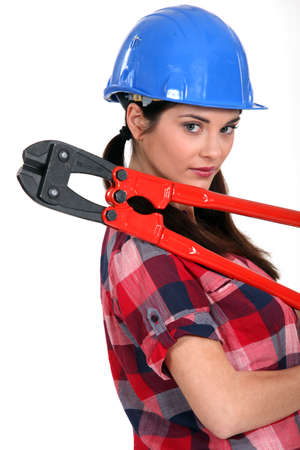 tradesperson: Female construction worker holding a pair of heavy-duty clippers