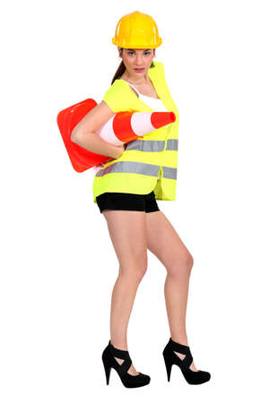 road worker: Hot woman with a traffic cone Stock Photo