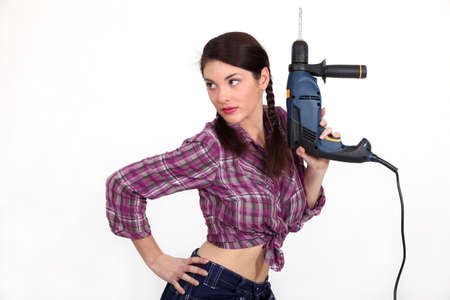 craftswoman holding a drill photo