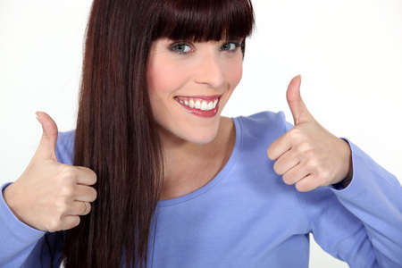 non verbal: Attractive woman giving two thumbs up