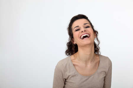 laughing out loud: Gorgeous woman laughing out loud Stock Photo
