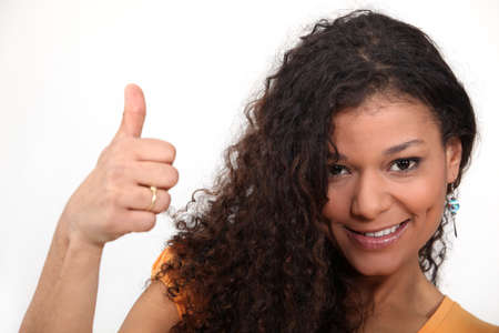 Woman with curly hair giving the thumb photo