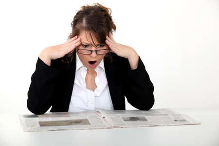 gazette: Shocked woman reading the newspaper