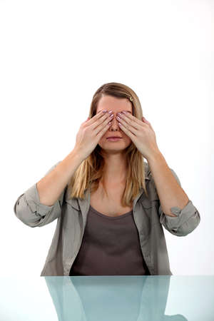 Woman covering her eyes Stock Photo - 15832911