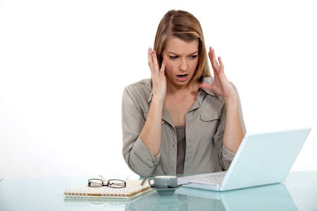 frustration girl: angry businesswoman looking at her laptop