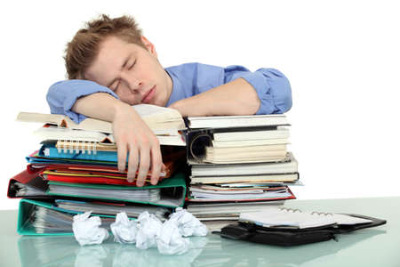 snoozing: Overworked office worker Stock Photo