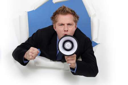 Businessman with a loudspeaker photo