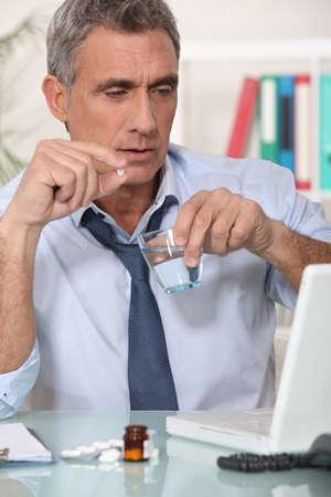 ecstasy pill: Businessman taking his medication