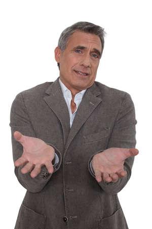 Senior businessman asking why Stock Photo - 15819354