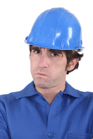 infuriate: head-and-shoulders portrait of craftsman looking exasperated