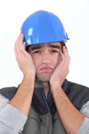 frowned: A depressed construction worker
