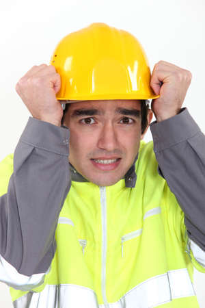 Construction worker protecting his head photo