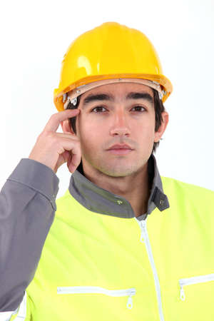 scratching head: Traffic guard scratching his head