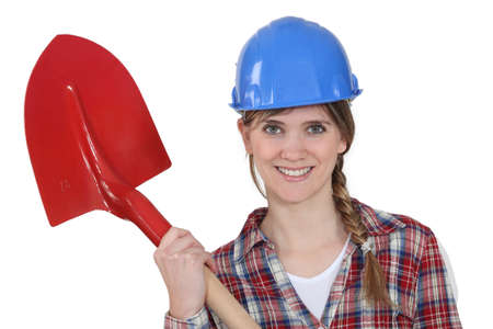 biased: beautiful blonde bricklayer holding shovel Stock Photo