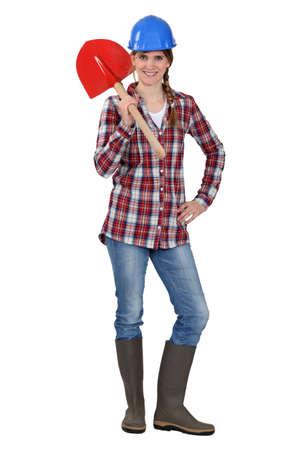 tradeswoman: Tradeswoman holding a spade