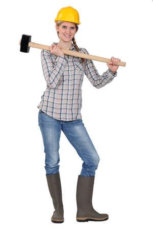 craftswoman: craftswoman holding a huge hammer