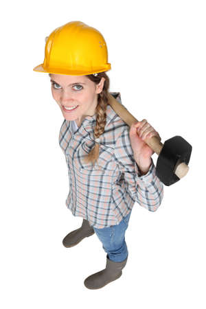 Female manual worker holding a sledge hammer Stock Photo - 15832782