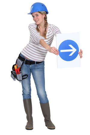 one way: Woman with a one way sign Stock Photo