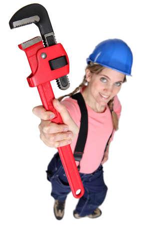 craftswoman: craftswoman holding a spanner