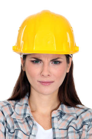 unsatisfied: An unsatisfied female construction worker