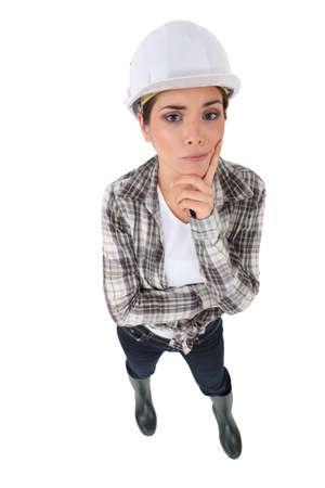 workwoman: Portrait of an unsure tradeswoman Stock Photo