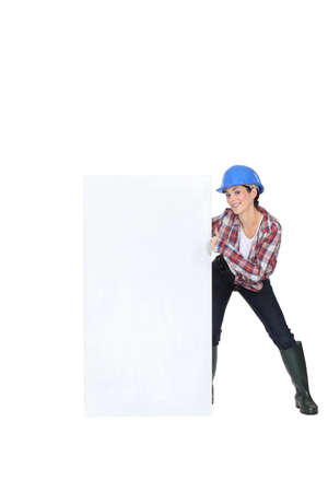 Woman laborer showing white board for message Stock Photo - 15832691