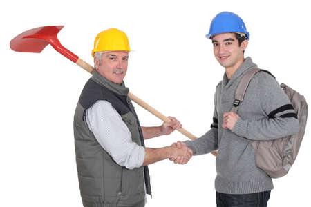 self help: craftsman and apprentice shaking hands